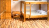stock-photo-clean-hostel-room-with-wooden-bunk-beds-409186855